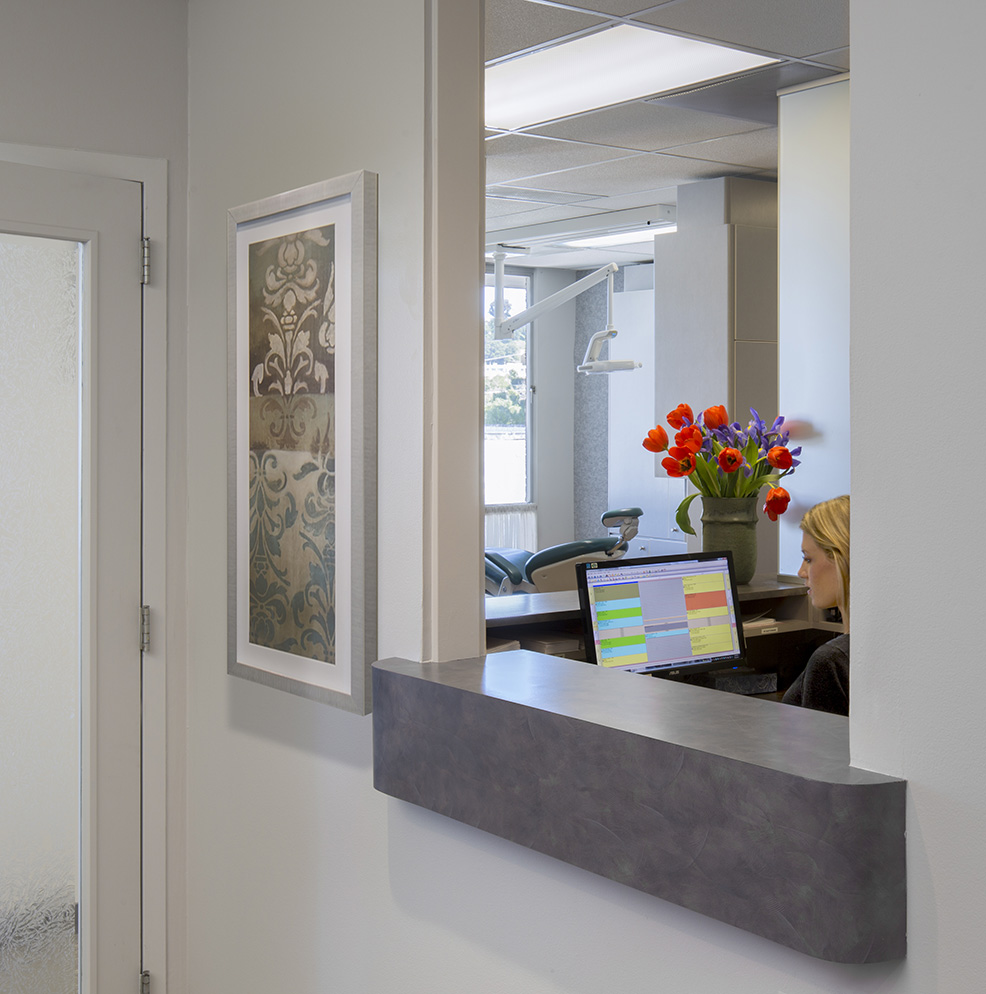 Dental Office Entrance Lobby woman and flowers at desk