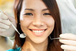 Young Girl Patient and Dentist With Teeth Cleaning Tools