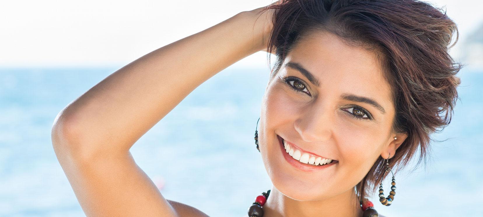 Happy Woman Smiling on Beach Beautiful Healthy Teeth