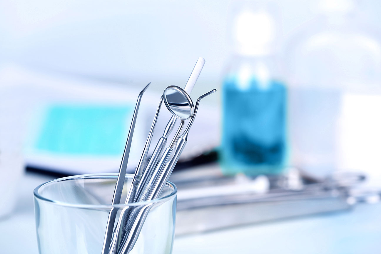 Teeth Cleaning Tools Standing Up In A Plastic Container in Dental Exam Room