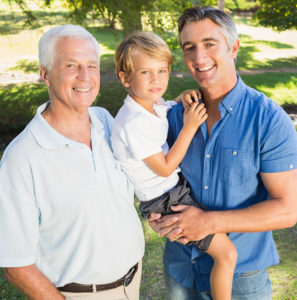 Grandpa Dad and Son Smiling in Park Setting