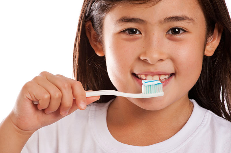 Young Girl Brushing Teeth
