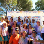 Dr. Catherine Cox celebrating at the Finish Line of the Marin 5k Color Run that supports local charities