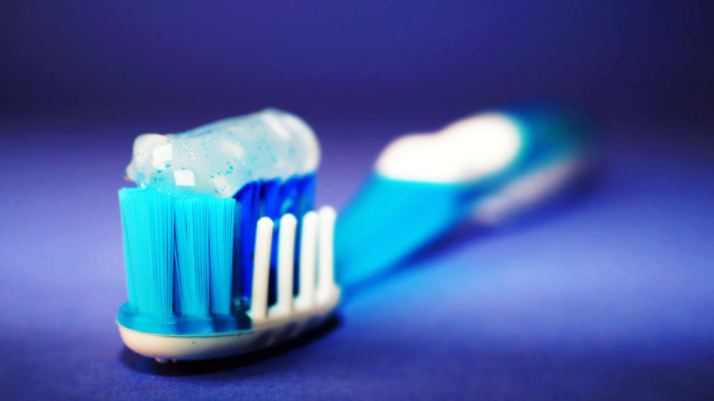Tooth Brush with Close Up Loaded With Toothpaste