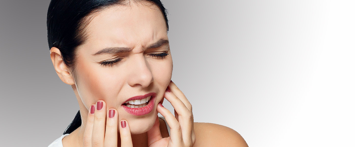 Woman Showing Signs of Tooth Pain