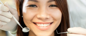 Woman Smiling After Receiving Dental Implants