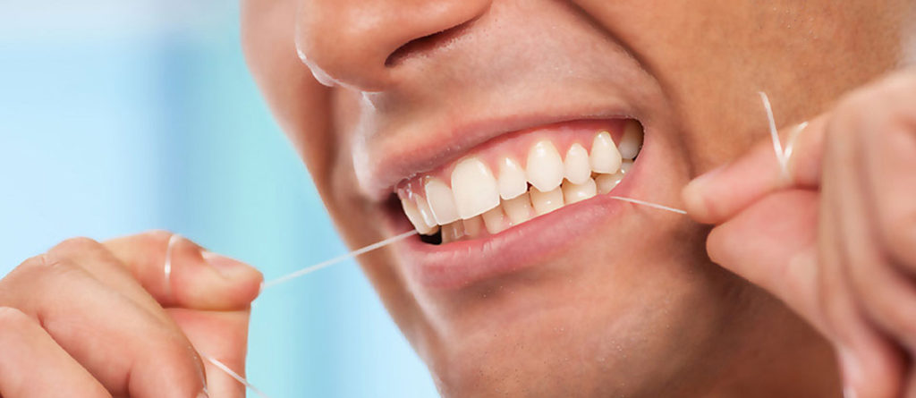 Man Flossing Lower Teeth