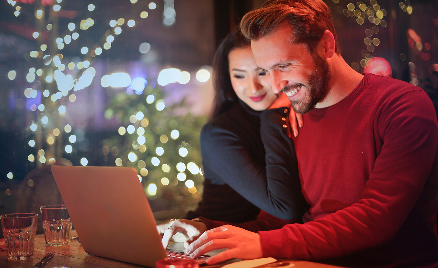 Smiling Man and Woman Planning 2019 New Years Dental Health Resolutions